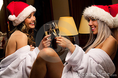 Sexy girls in Santa hats waiting for New Year