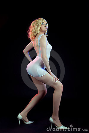 Sexy gold blond woman posing white fashion cloth