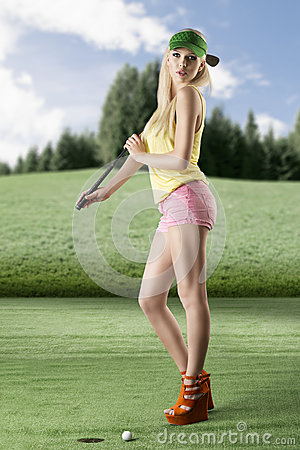 Sexy golf player woman with golf club