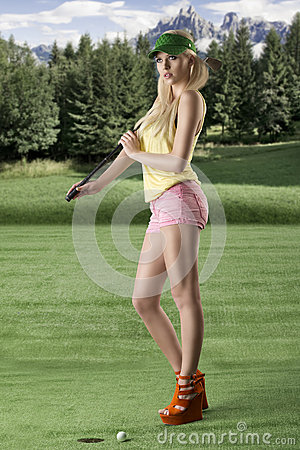 Sexy golf player woman turned of three quarters