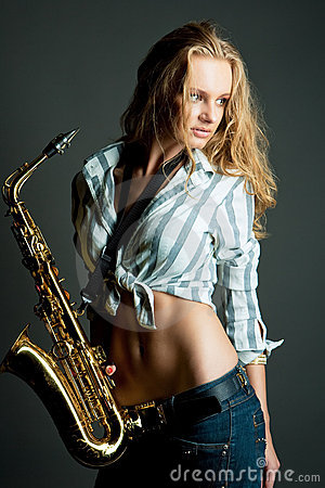 Sexy gorgeous young pretty blonde with sax
