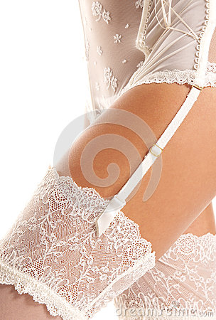 Sexy hips of a woman in white erotic lingerie
