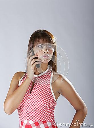 Sexy hispanic lady talking on cellular phone