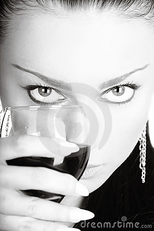 Sexy lady with a glass of red wine