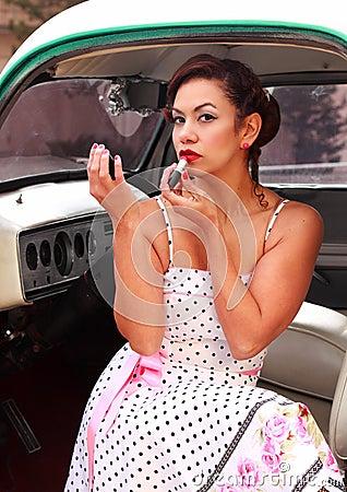 Sexy Latina Pinup Girl Putting on Lipstick