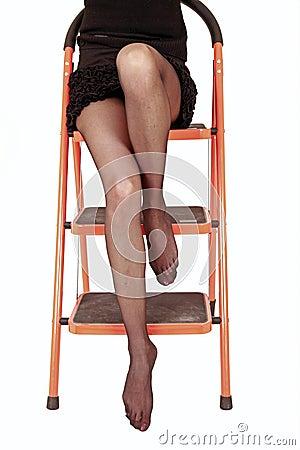 Sexy legs on ladder