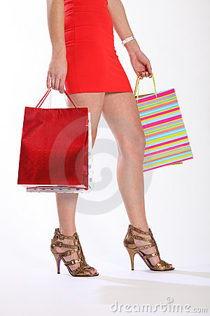 Sexy legs of woman walking with shopping bags