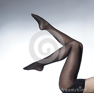 Sexy legs of a young woman in black stockings