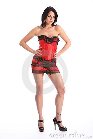 Sexy long legs beautiful woman in red corset skirt