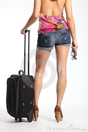 Sexy long legs of woman waiting with suitcase