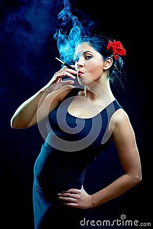 Sexy looking spanish women smoking cigarette