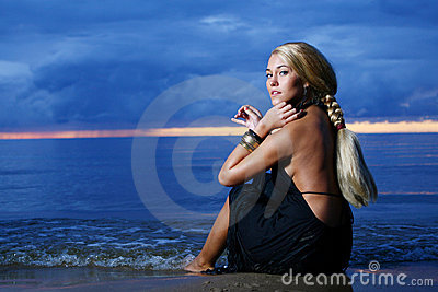 Sexy and luxury woman on the sunset backgroung