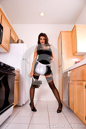 Sexy maid in kitchen.