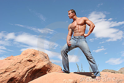 Sexy male model with sixpack abs in blue jeans