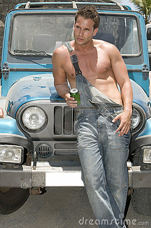 Sexy man in a car drinking beer