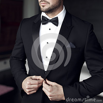 Free Sexy Man In Tuxedo And Bow Tie Stock Photography - 65994522