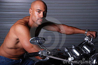 Sexy man on motor cycle.