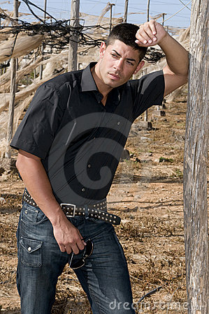 Sexy man posing in desolated landscape