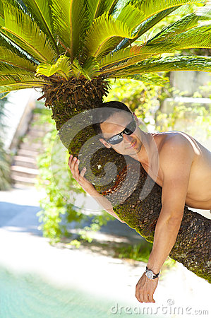 Sexy man at tropical resort