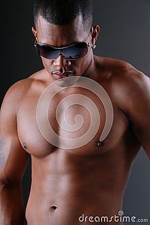 Sexy man wearing sunglasses.