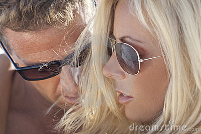 Sexy Man and Woman Couple In Sunglasses