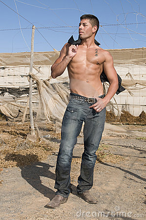 Sexy muscled man with jeans in desolated place