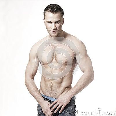Sexy muscular macho man smiling