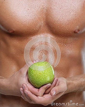 Sexy nat naakt de jonge mensentorso en appel van de spier
