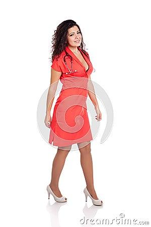 Sexy nurse or doctor walking