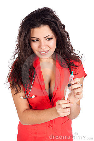 Sexy nurse or woman doctor with syringe