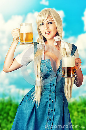 Free Sexy Oktoberfest Girl Holding Two Beer Mugs Stock Photo - 33698920