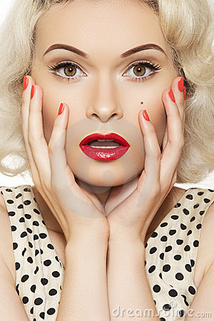 Sexy pin-up girl with retro make-up, red manicure