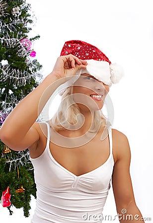 Sexy playful blonde near christmas tree