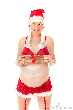 Sexy pregnant woman as Santa Claus