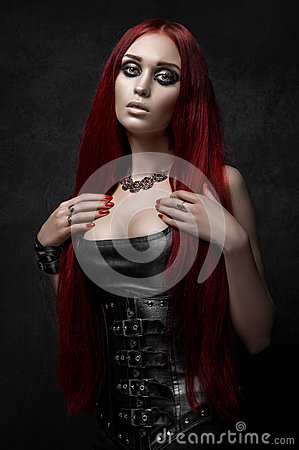 Free Sexy Red Haired Woman In Black Leather Clothes Royalty Free Stock Image - 70451386