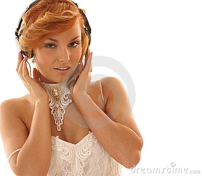 Sexy redhead girl is listening to the music