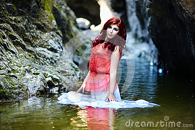 Sexy redhead standing in water