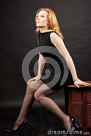 Sexy redhead woman sitting