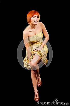 Sexy redhead in yellow dress