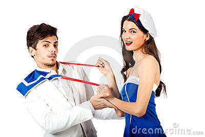 Sexy sailor woman seducing elegant young man