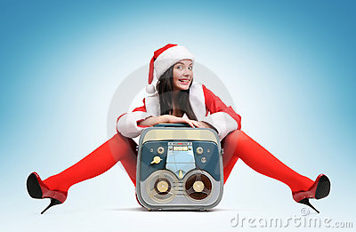 Sexy Santa girl with vintage tape recorder