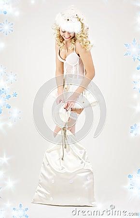Sexy santa helper girl with big bag