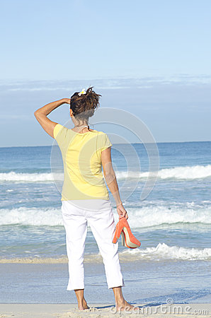 Sexy single lady at beach background