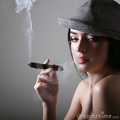 Sexy smoking beautiful woman cigar