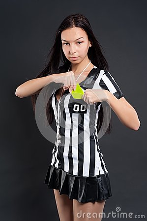 Sexy Soccer Referee with yellow card