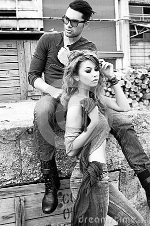 Sexy and stylish young couple wearing jeans