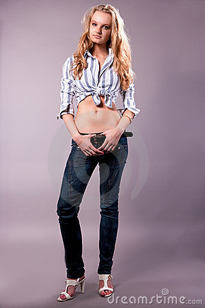 Sexy tall pretty young blonde girl in jeans