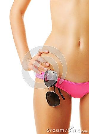 Sexy tan woman in bikini close-up