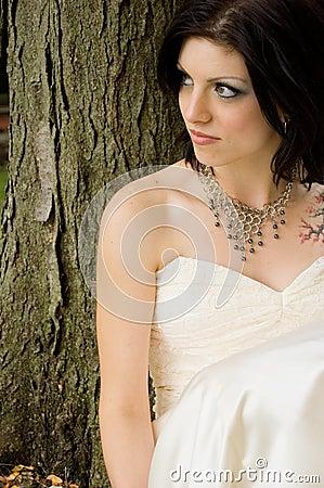 Sexy tattoo woman in bridal dress
