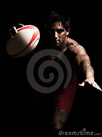 Sexy topless rugby man scoring touchdown